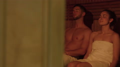 Couple relaxing in sauna together - stock footage