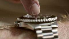Man's finger tapping watch. He's late or he's waiting or just checking. Stock Footage
