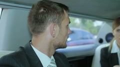 Conversation of business partners in a limousine Stock Footage