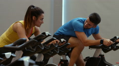 Fit couple spinning in gym Stock Footage