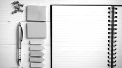 Notepad with office supplies black and white tone color style Stock Photos