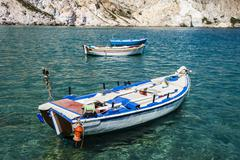 Traditional fishing boats in Milos island Greece - stock photo