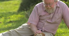 Grandfather retired elderly mature senior adult male in 60s retirement with dog  - stock footage