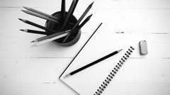 notepad with color pencil black and white color style - stock photo