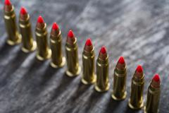 Cartridges ranked with red tip - stock photo