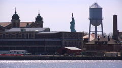 Stock Video Footage of A view of Ellis Island with the Statue Of Liberty in distance.