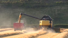 Combine and tractor harvester barley Stock Footage