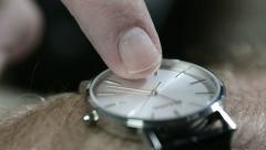Man tapping his watch. He's late or he's waiting or simply checking. Stock Footage