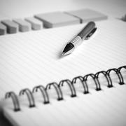 notepad with office supplies black and white tone color style - stock photo