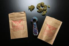 Legal Cannabis Packages and Pipe - stock photo