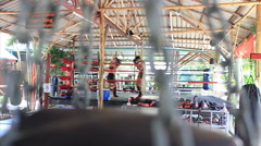 Boxing Muay Thai Training In Ring Gym Heavy Bag Chain in Foreground Slow Motion Stock Footage