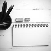 Stock Photo of notepad with color pencil black and white color style