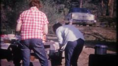 2622 - camping, cooking in campground with family - vintage film home movie Stock Footage