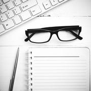 computer and notepad black and white tone color style - stock photo