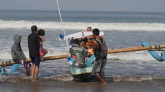 Tourists getting on boat for tour,Pangandaran,Java,Indonesia Stock Footage