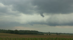 Severe thunderstorm with ominous cloud moves in over farm field Stock Footage
