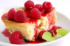 Cake with raspberries and cream cheese decorated with fresh raspberries and m Stock Photos