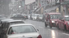 Heavy rains on an urban street in Singapore with moderate traffic. Stock Footage