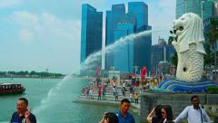 Crowds of tourists viewing and photographing the Singapore Merlion Fountain Stock Footage
