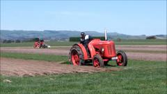 Plowman reaches the end of a furrow. - stock footage