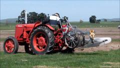 Plowman starts new furrow. - stock footage