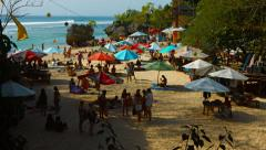 Large crowd of tourists on the beautiful and picturesque beach on Bali Stock Footage