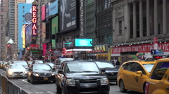 Traffic passes along Broadway with signs advertising the latest shows. Stock Footage