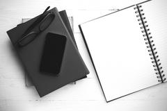 notepad with stack of book black and white tone color style - stock photo