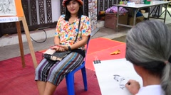 Old man artist drawing and sketch thai woman Stock Footage