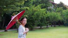 Oriental red umbrella with asian girl Stock Footage