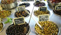 Olives and olive oil at French market Stock Footage