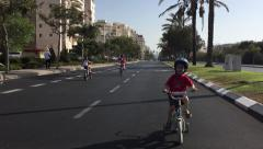 Israelis kids ride bycicles on Yom Kippur Stock Footage