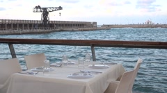 Tel-Aviv Port romantic dinner table setup at the waterfront Stock Footage