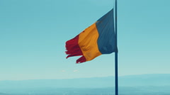 Ripped Romanian Flag Stock Footage