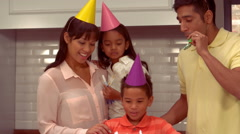 Smiling Hispanic family celebrating the birthday of his son Stock Footage