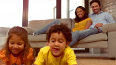 Smiling Hispanic family in the living room Stock Footage