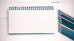 Stock Photo of notepad with color pencil vintage style