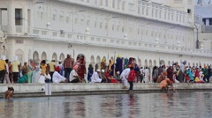 Sikhs and indian people visiting Golden Temple in Amritsar, Punjab, India Stock Footage