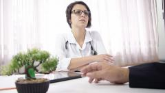 Glasses woman doctor listen patient, give information, health status exam room - stock footage