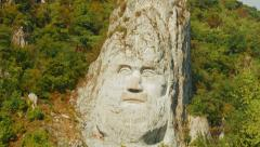 Decebalus (Decebal) king rock statue by the Danube River on a sunny day Stock Footage