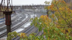 The first snow in the autumn leaves and train tracks Stock Footage