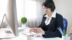 Attractive formal black wear businesswoman work take note in modern office - stock footage