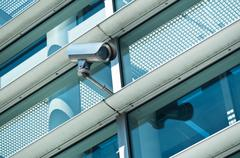 Electronic security video camera of surveillance Stock Photos
