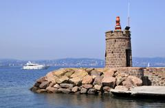 Lighthouse of the port of Théoule-sur-Mer in France - stock photo
