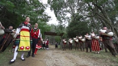 Bulgarian bagpipers in traditional costumes perform at folk festival Stock Footage
