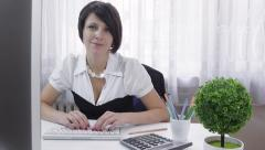 Formal wear businesswoman working, looking at camera, smiling Stock Footage