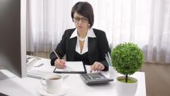 Serious, spectacles accountant businesswoman working, contemporary office, dolly - stock footage