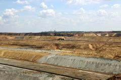open pit coal mine with excavators - stock photo