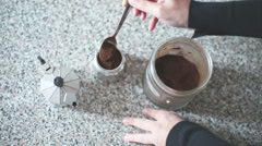 Hands making a coffee with italian coffeepot Stock Footage