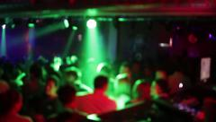 People having fun at the disco party club with lights blurry de-focused 21 - stock footage